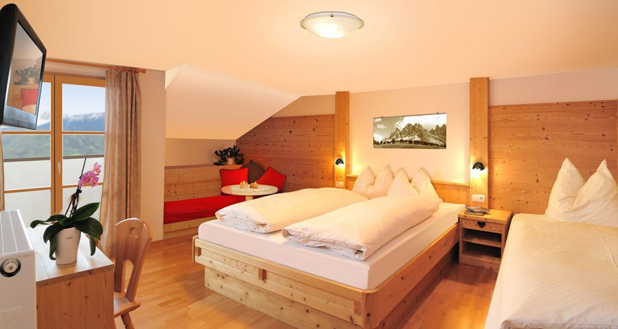 Bedroom holiday guest room in the Dolomites